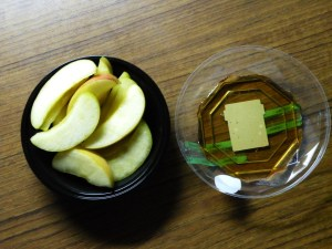 Dipping the Apples in the Maple Syrup